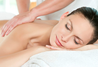 One-Hour Therapeutic, Sports, or Deep Tissue Massage incl. $30 Return Voucher