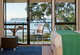 Two-Night Coromandel Beachfront Break for Two People incl. Free WiFi, Late Checkout, Use of Kayaks, Beach Bar, BBQ & Spa Pool - Options for Three Nights