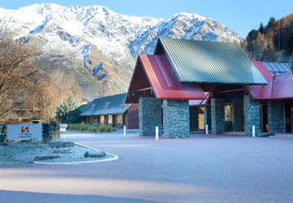 One-Night Queenstown Getaway for Two-People incl. Daily Breakfast, Dinner Special, Wifi, Game of Bowling, Car Park & Late Checkout  - Options for Two Nights & Family Available