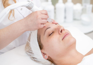 Microdermabrasion Facial & Eyebrow or Lash Tint for One Person