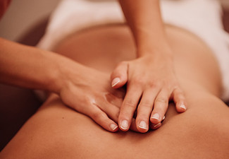 90-Minute Thai Massage with Hot Stone & Warm Oil - Options for Relaxation Massage or Deep Tissue Massage