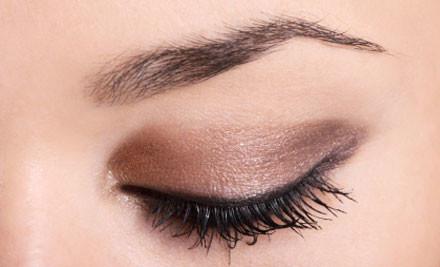 $49 for a Brazilian Wax, Spray Tan & Eyebrow Shape at Gloss Beauty (value $98)