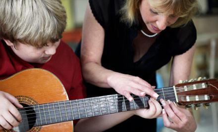 $159 for 10 One-Hour Beginner Guitar Lessons, a Guitar, a Guitar Carry Case, a Music Score Bag & Registration (value $459)