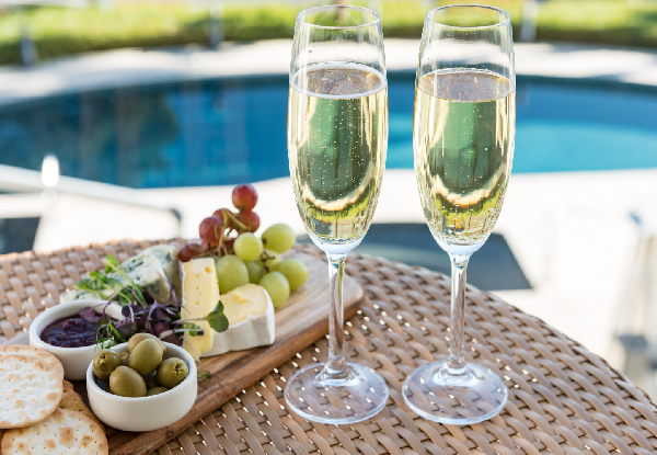 Luxurious Spa Massage Treatment for Two incl. a Glass of Wine Each & Platter Poolside - Options for Essential Facial, Manicure or Pedicure Spa Treatment - Valid Monday - Friday Only