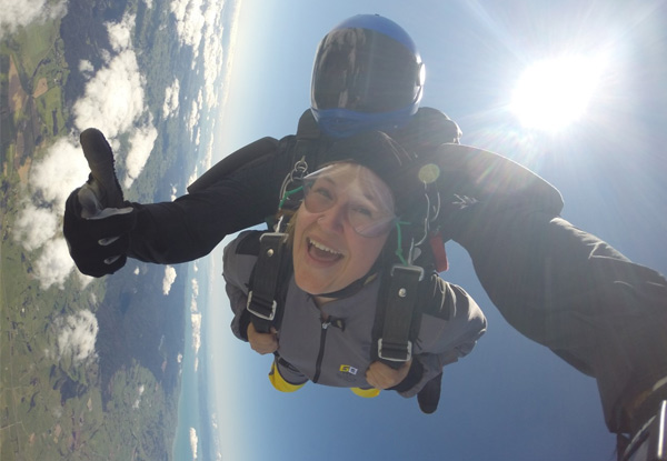 13,000-Feet Tandem Skydive Package with Views of NZ's Biggest City & Beyond incl. a Voucher Towards Photo or Video or Combo - Options for 9,000 & 7,500 Feet & Two People