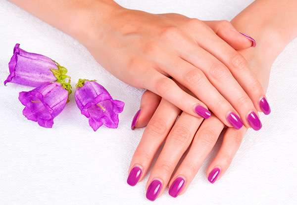 Deluxe Manicure or Pedicure - Option for Gel Polish